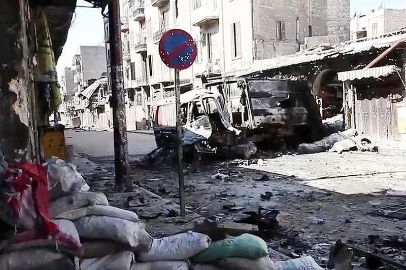 戦闘で破壊された車両=2012年、アレッポで(写真:Voice of America)