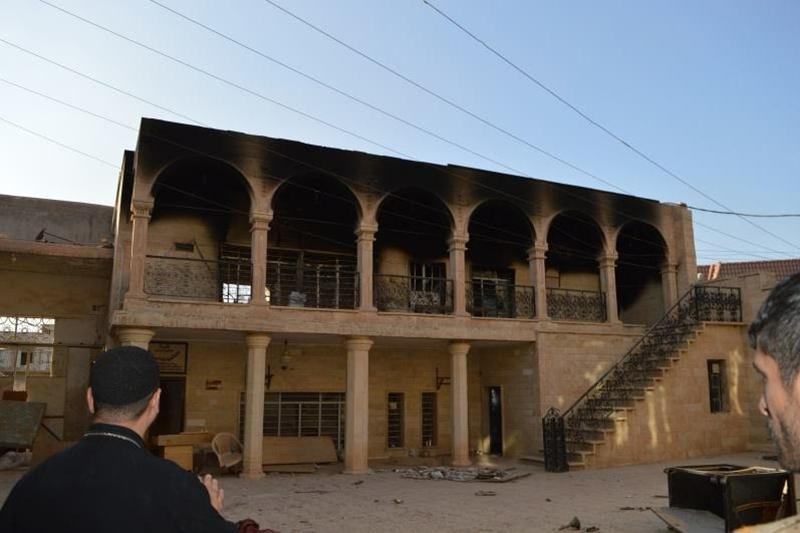イラク北部の町バーテリアにある黒く焼け焦げた教会(写真:ア・デマンド・フォー・アクション=ADFA)<br />