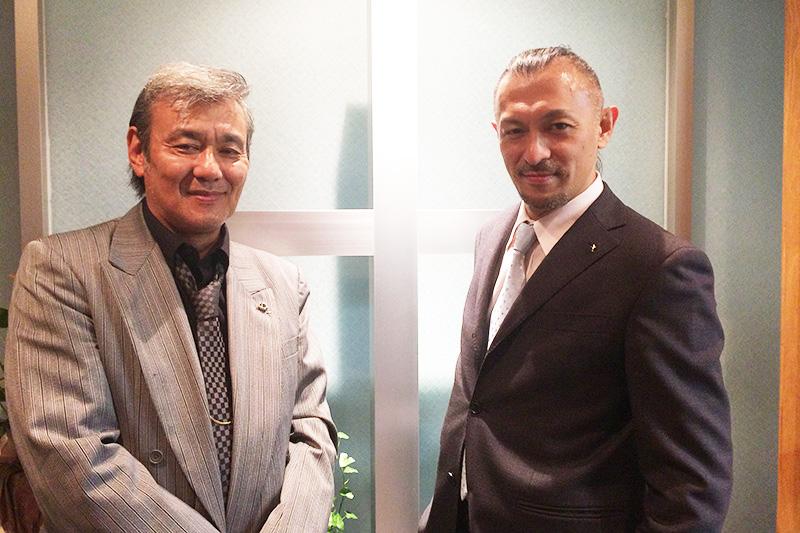 進藤龍也牧師(右)と小川一実さん。神の起こした奇跡が巡り合った。