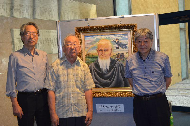 左から石飛仁さん、実行委員の北畠啓行さん、実行委員の須山さん=21日、台東地域センターで