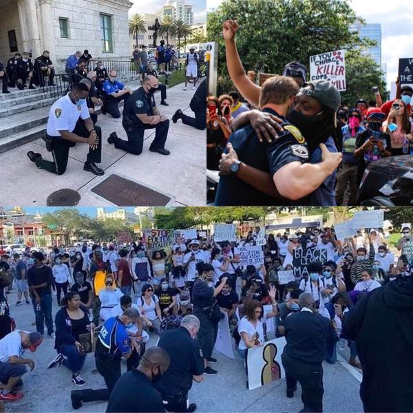 米黒人死亡事件、警官がデモ隊と共に祈る 「これまで以上の祈りが必要」