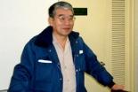 いつもの作業服姿で講演する元祖便利屋の右近勝吉さん=18日、お茶の水クリスチャンセンターで
